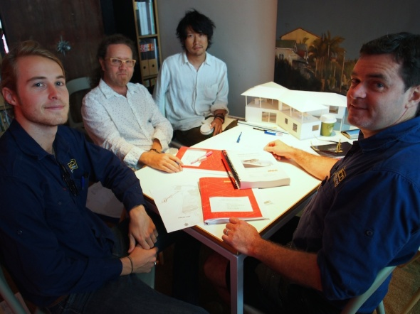 Builder, Cameron McDonald (far right) with his trusty money man Tom (left) discuss the terms.